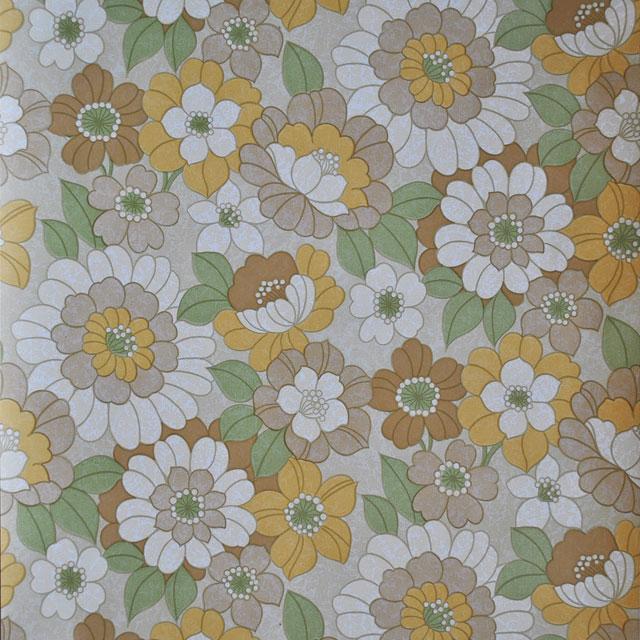 Fonkelnieuw Bloem behang in okergeel, bruin en beige met groen blad UM-87